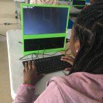Kid navigating Linux File System using Command Line