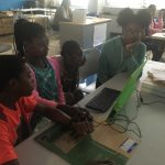 Kids working together in teams to solve the challenge