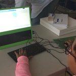 Kid coding animation of bouncing balls.
